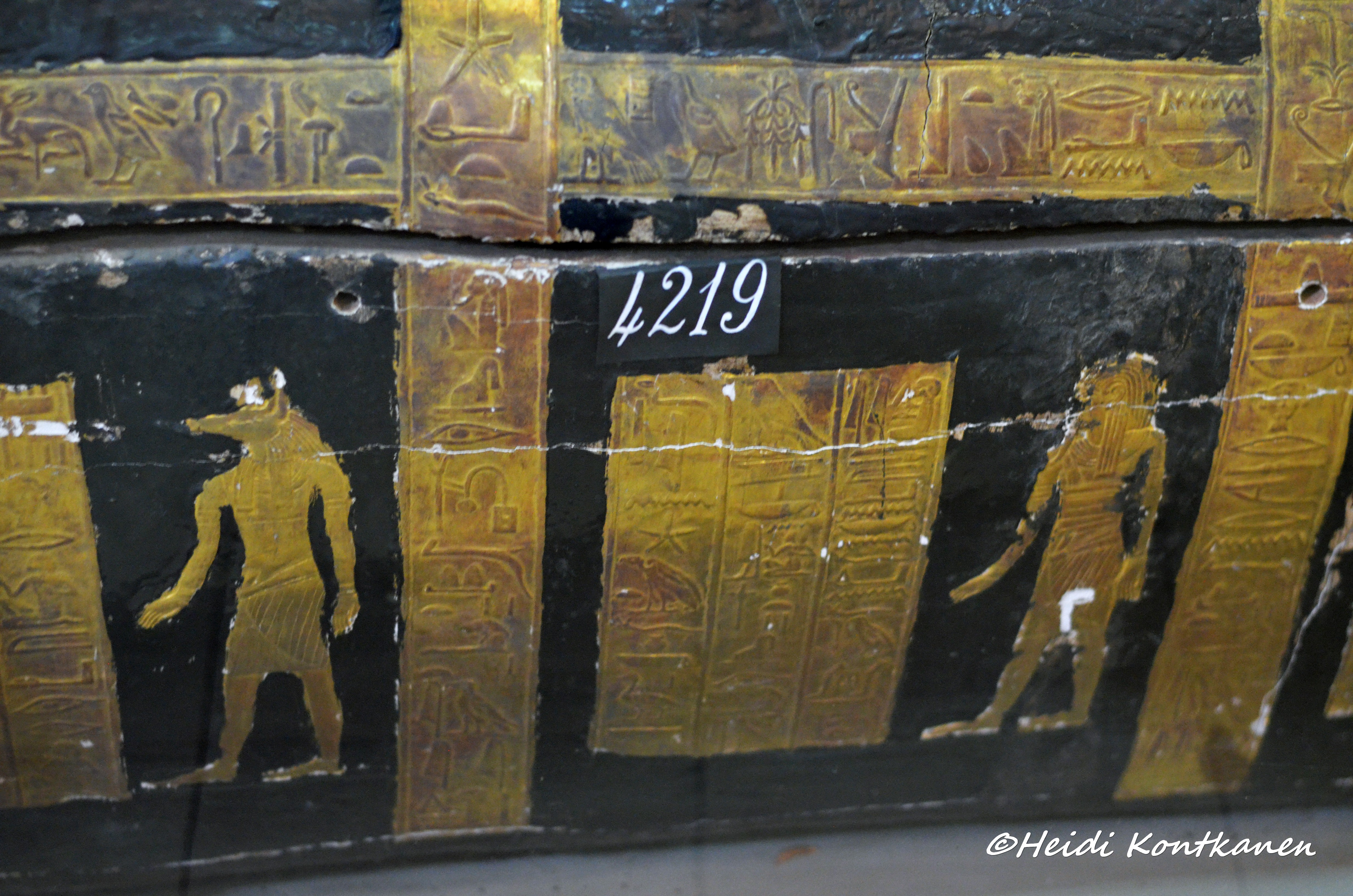 Side of outer coffin with gilded figures and text