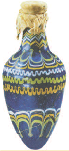 Blue, green, yellow, and white striped glass vase with tan fabric covering the top.